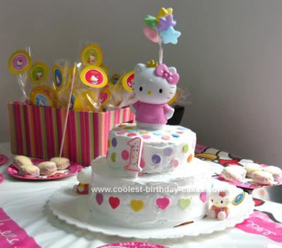 I made this cake Hello Kitty Birthday Cake for my daugther's first birthday.