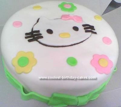 "This Homemade Hello Kitty Birthday Cake is a 10"" round covered in white"